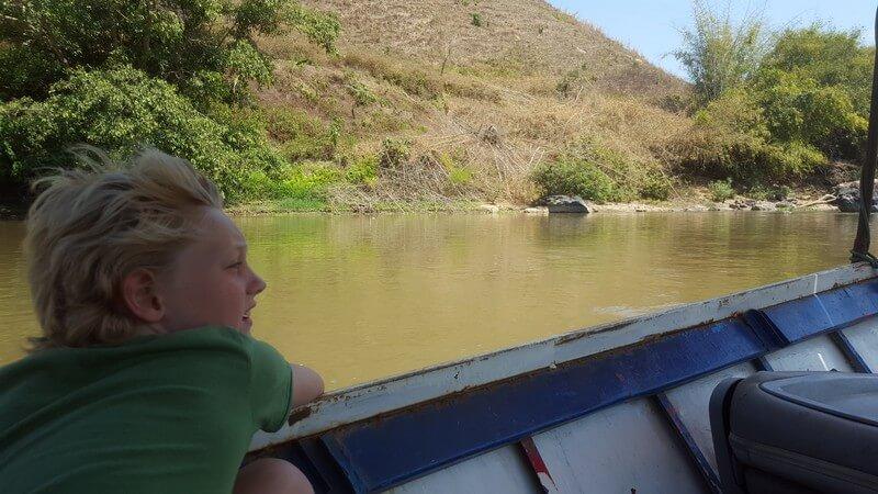 Tai enjoying the boat ride from Thaton to Chiang Rai on the Kok River