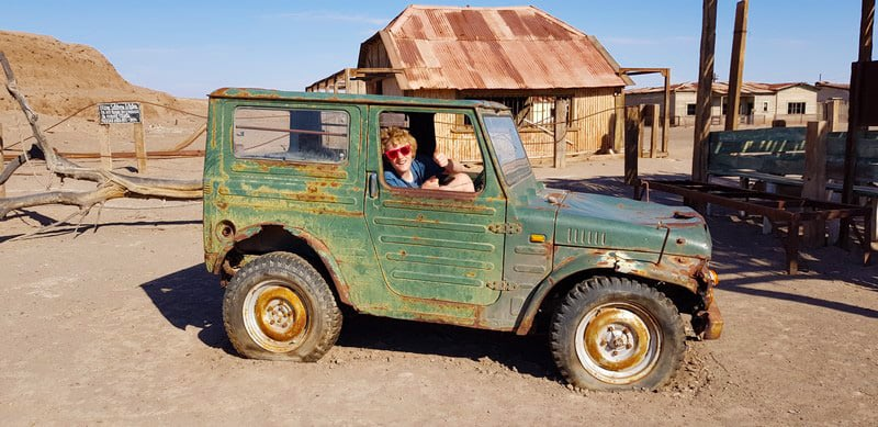 Rusting jeeps at Humberstone abandoned town in the atacama desert